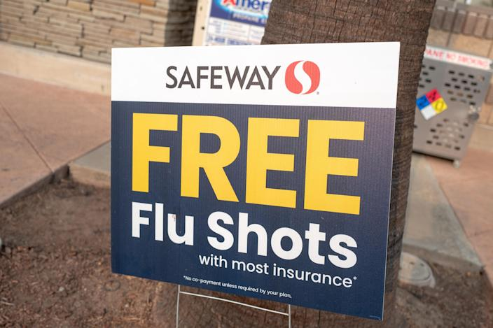 Sign advertising free influenza vaccines (flu shots) for patients with insurance coverage at Safeway supermarket, San Ramon, California, September 12, 2020. (Photo by Smith Collection/Gado/Getty Images)