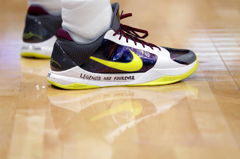 New Orleans Pelicans guard Josh Hart bears a memorial message on his shoes for former NBA great Kobe Bryant, who died today in a helicopter crash, in the first half of an NBA basketball game against the Boston Celtics in New Orleans, Sunday, Jan. 26, 2020. (AP Photo/Gerald Herbert)