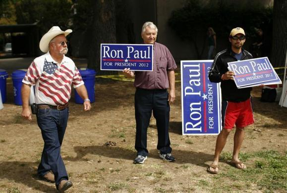 Supporters of Ron Paul listen to speakers during a Tea Party rally in Napa, California August 27, 2011. (REUTERS/Robert Galbraith)