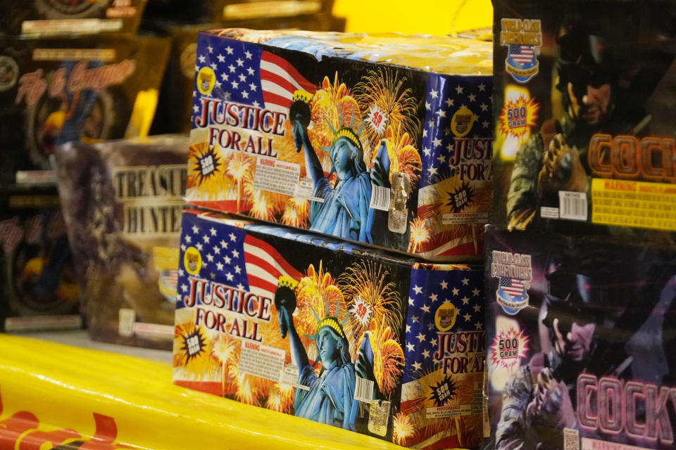 Boxes for fireworks are shown in fireworks vendors tent Thursday, June 24, 2021, in Sandy, Utah. Many Americans aching for normalcy as pandemic restrictions end are looking forward to traditional Fourth of July fireworks. But with a historic drought in the U.S. West and fears of another devastating wildfire season, officials are canceling displays, passing bans or begging for caution. (AP Photo/Rick Bowmer)