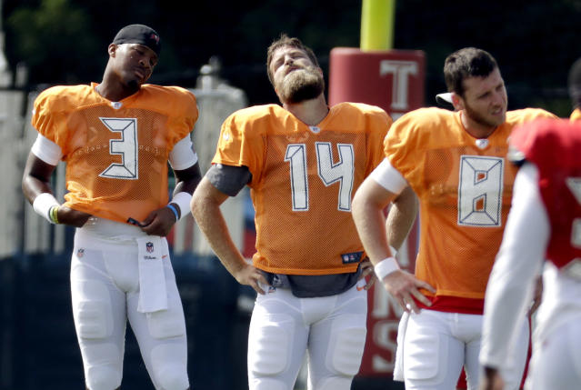 Tampa Bay Buccaneers quarterbacks Jameis Winston (3), Ryan Fitzpatrick (14), and Austin Allen (8) stretch during a combined NFL football training camp with the Tennessee Titans Wednesday, Aug. 15, 2018, in Nashville, Tenn. (AP Photo/Mark Humphrey)