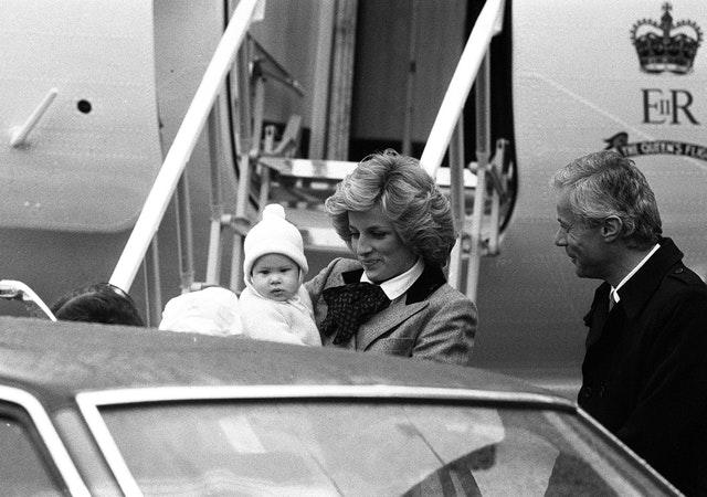 Prince Harry carried by Diana at airport