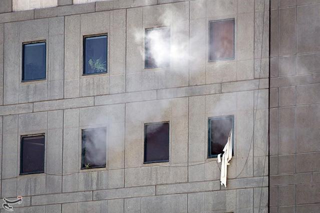 <p>Smoke is seen during an attack on the Iranian parliament in central Tehran, Iran, June 7, 2017. (Photo: Tasnim News Agency/Handout via Reuters) </p>