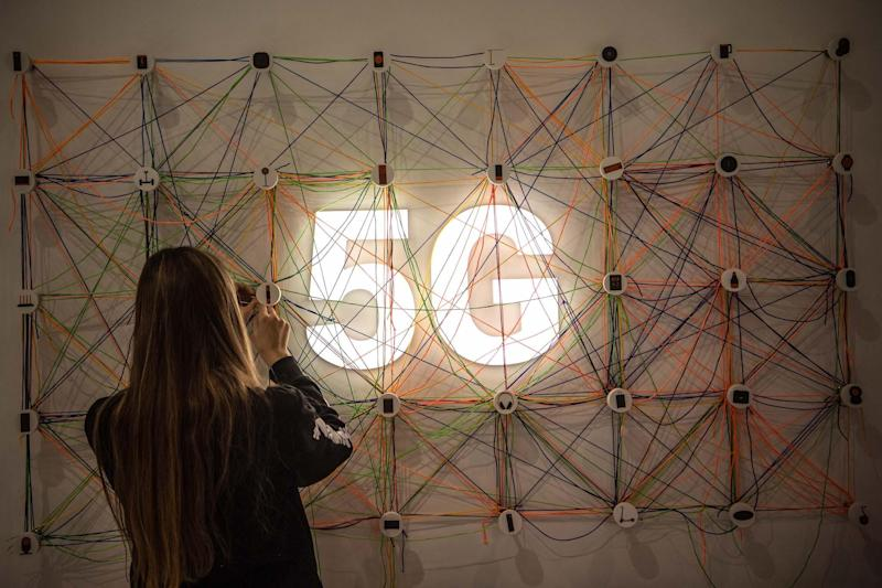 A staff member works next to a 5G logo at the Xiaomi booth on day 2 of the GSMA Mobile World Congress 2019 on February 26, 2019 in Barcelona, Spain: David Ramos/Getty Images