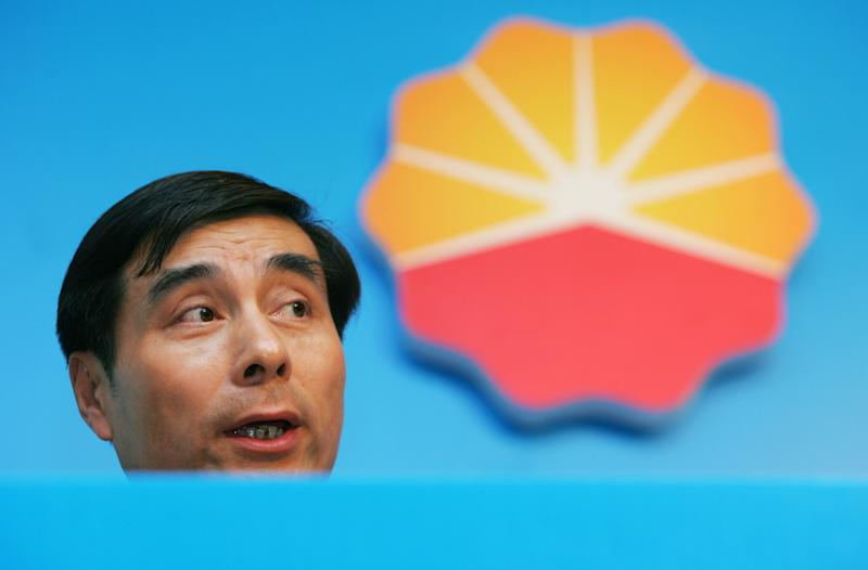 File photo of Wang Guoliang, then CFO of PetroChina, announcing company results during a news conference in Hong Kong