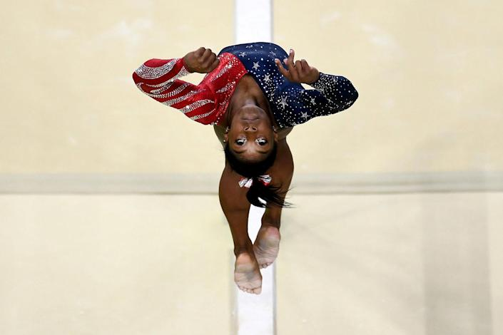 <p>AUG. 7, 2016 — Simone Biles of the United States competes on the balance beam during Women's qualification for Artistic Gymnastics on Day 2 of the Rio 2016 Olympic Games at the Rio Olympic Arena in Rio de Janeiro, Brazil. (David Ramos/Getty Images) </p>