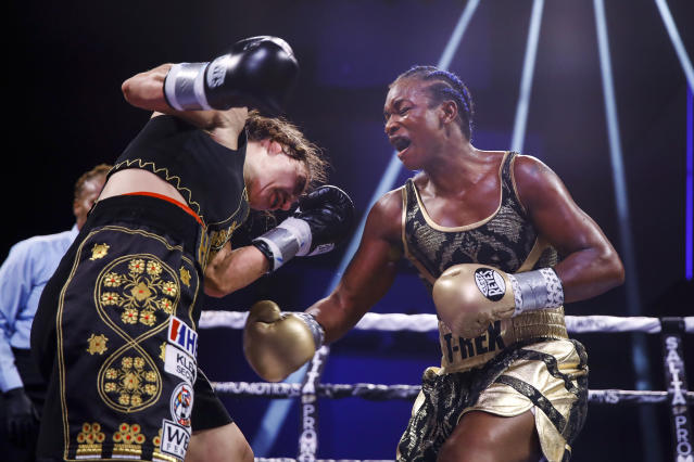 Claressa Shields, right, fights with Ivana Habazin during the seventh round of a women's 154-pound title boxing bout in Atlantic City, N.J., Friday, Jan. 10, 2020. (AP Photo/Matt Rourke)