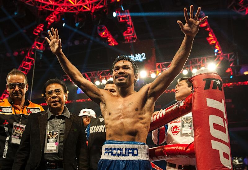 Manny Pacquiao is confident he can beat American arch-rival Floyd Mayweather in Las Vegas with the power of God (AFP Photo/Xaume Olleros)