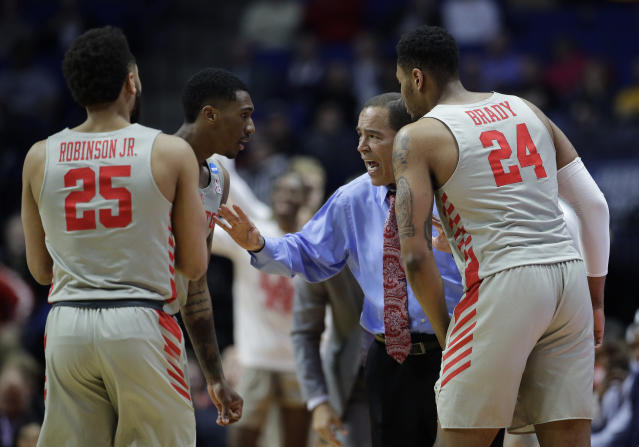 Houston head coach Kelvin Sampson talks to his players during the first half of a first round men's college basketball game against Georgia State in the NCAA Tournament Friday, March 22, 2019, in Tulsa, Okla. (AP Photo/Charlie Riedel)