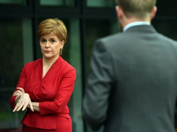 Nicola Sturgeon talks to staff at West Calder High School yesterday (AFP/Getty)