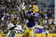 LSU wide receiver Brian Thomas Jr. (11) catches a pass next to Central Michigan defensive back Daedae Hill (6) during the second quarter of an NCAA college football game in Baton Rouge, La,. Saturday, Sept. 18, 2021. (AP Photo/Derick Hingle)