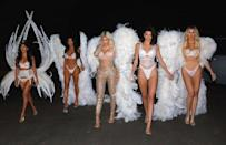 """<p>The whole Kardashian/Jenner crew stripped down to their lingerie for Halloween, borrowing wings and underwear from Victoria's Secret. Collectively, the sisters showed off a lot of skin as they strutted around in their looks. </p><p><a href=""""https://www.instagram.com/p/BpnJt8AhoAR/?utm_source=ig_embed&utm_medium=loading"""" rel=""""nofollow noopener"""" target=""""_blank"""" data-ylk=""""slk:See the original post on Instagram"""" class=""""link rapid-noclick-resp"""">See the original post on Instagram</a></p>"""