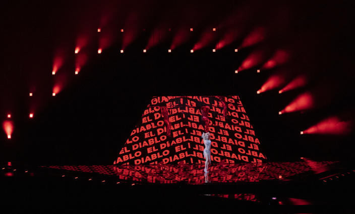 In this photo taken on May 12, 2021, Cyprus' performer Elena Tsagrinou rehearses her song El Diablo at the Eurovision Song Contest at Ahoy arena in Rotterdam, Netherlands. Tsagrinou has already been in the spotlight after Orthodox Christian faithful on the Mediterranean island protested that it promoted satanic worship. Tsagrinou says her song El Diabolo, which she performs flanked by four dancers in skin-tight red costumes, was misinterpreted and is actually about an abusive relationship between two lovers. (AP Photo/Peter Dejong)
