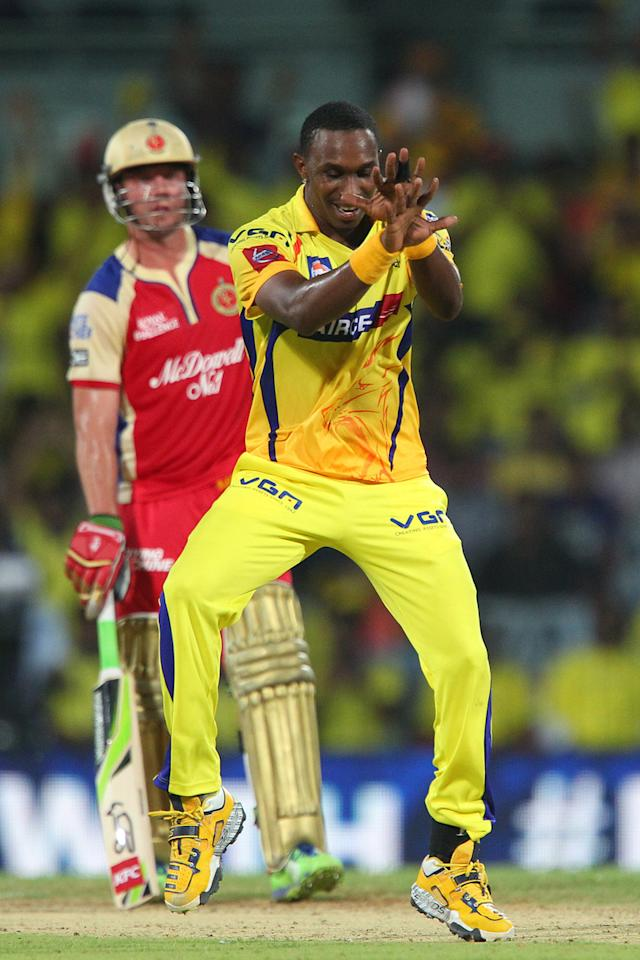 Dwayne Bravo celebrates the wicket of Ravi Rampaul as AB de Villiers looks on during match 16 of the Pepsi Indian Premier League between The Chennai Superkings and the Royal Challengers Bangalore held at the MA Chidambaram Stadiumin Chennai on the 13th April 2013..Photo by Ron Gaunt-IPL-SPORTZPICS  .. .Use of this image is subject to the terms and conditions as outlined by the BCCI. These terms can be found by following this link:..https://ec.yimg.com/ec?url=http%3a%2f%2fwww.sportzpics.co.za%2fimage%2fI0000SoRagM2cIEc&t=1495880746&sig=qm4CkQ0A7.LtEIqxuMulPw--~C