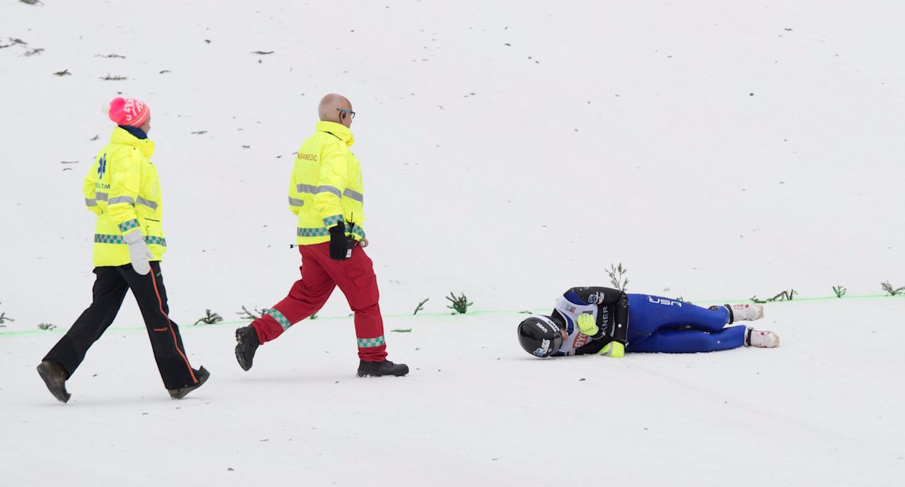 Kevin Bickner from USA is approached by paramedics, after falling in the second round of FIS Ski Jumping World Cup, Men's HS225 in Vikersund, 19 March, 2017. NTB Scanpix/Terje Bendiksby/via REUTERS ATTENTION EDITORS - THIS IMAGE WAS PROVIDED BY A THIRD PARTY. EDITORIAL USE ONLY. NORWAY OUT.
