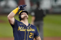 Milwaukee Brewers' Daniel Vogelbach celebrates after hitting a solo home run during the fourth inning of a baseball game against the St. Louis Cardinals Saturday, Sept. 26, 2020, in St. Louis. (AP Photo/Jeff Roberson)
