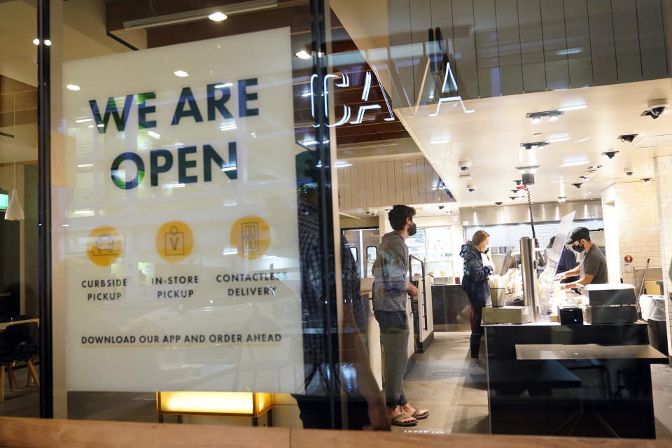 FILE - In this March 16, 2021 file photo, a sign advertises a restaurant opening in Santa Monica, Calif. A rapid and sustained increase in COVID-19 cases in the nation's largest county requires restoring an indoor mask mandate even when people are vaccinated, Los Angeles County's public health officer said Thursday, July 15, 2021. (AP Photo/Marcio Jose Sanchez, File)