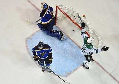 Dallas Stars left wing Patrick Sharp (10) celebrates after the game winning goal scored by Cody Eakin (not pictured) against St. Louis Blues goalie Brian Elliott (1) during the overtime period in game four of the second round of the 2016 Stanley Cup Playoffs at Scottrade Center. The Dallas Stars defeat the St. Louis Blues 3-2. Mandatory Credit: Jasen Vinlove-USA TODAY Sports