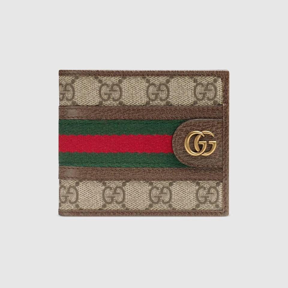 """<p><strong>Gucci</strong></p><p>gucci.com</p><p><strong>$430.00</strong></p><p><a href=""""https://go.redirectingat.com?id=74968X1596630&url=https%3A%2F%2Fwww.gucci.com%2Fus%2Fen%2Fpr%2Fmen%2Faccessories-for-men%2Fwallets-and-small-accessories-for-men%2Fbi-fold-wallets-for-men%2Fophidia-gg-wallet-p-59760696IWT8745&sref=https%3A%2F%2Fwww.esquire.com%2Fstyle%2Fmens-accessories%2Fg35924710%2Fmens-luxury-wallets%2F"""" rel=""""nofollow noopener"""" target=""""_blank"""" data-ylk=""""slk:Shop Now"""" class=""""link rapid-noclick-resp"""">Shop Now</a></p><p>Doesn't get much more iconic than the """"GG"""" <em>and</em> the green-and-red Gucci stripe.</p>"""