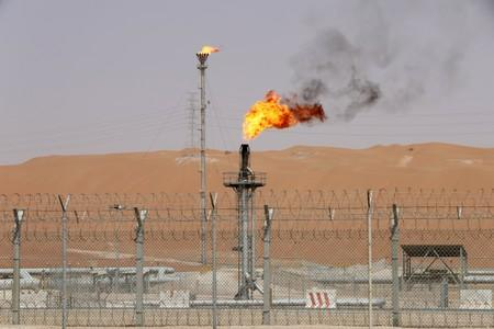 Flames are seen at the production facility of Saudi Aramco's Shaybah oilfield in the Empty Quarter