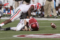 Georgia's Leonard Floyd (84) goes after a loose ball after tackling Arkansas quarterback Brandon Allen, bottom, in first quarter of an NCAA college football game in Little Rock, Ark., Saturday, Oct. 18, 2014. (AP Photo/Danny Johnston)