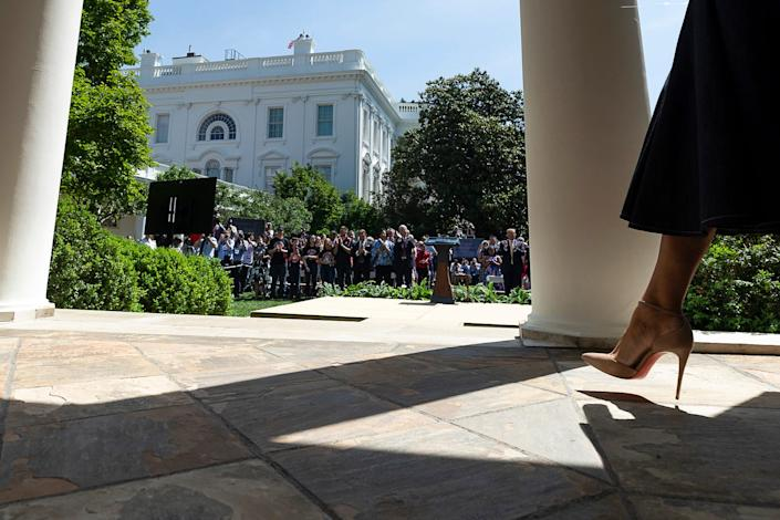 First Lady Melania Trump's stiletto heel is seen as she walks along the West Wing Colonnade Tuesday, May 7, 2019, prior to welcoming guests to the one year anniversary celebration of her Be Best initiative in the Rose Garden of the White House.