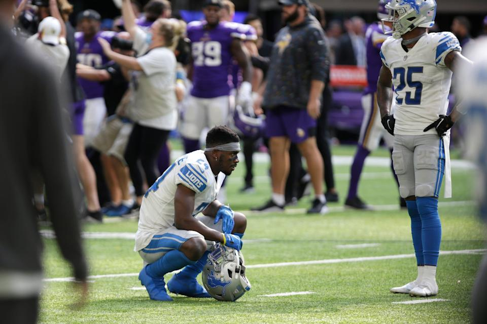 Detroit Lions cornerback Amani Oruwariye, left, and safety Will Harris react after the 19-17 loss to the Minnesota Vikings, Sunday, Oct. 10, 2021, in Minneapolis.