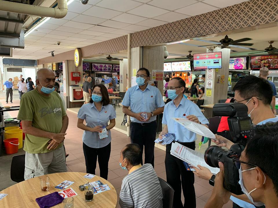 Workers' Party chair Sylvia Lim (second from left) alongside Azhar Abdul Latip and Yee Jenn Jong on a walkabout near Marine Terrace Market on Saturday, 4 July 2020. PHOTO: Amir Hussain/Yahoo News Singapore