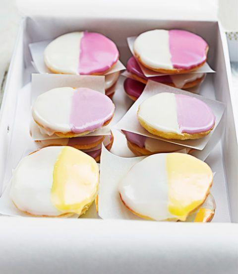 """<p>This fun, Easter-themed twist on the classic black and white cookies will look delightful on your dessert table, and the kids will have fun pitching in with the decorating. </p><p><strong><em><a href=""""https://www.womansday.com/food-recipes/food-drinks/recipes/a39599/mini-black-white-cookies-recipe-ghk0514/"""" rel=""""nofollow noopener"""" target=""""_blank"""" data-ylk=""""slk:Get the Mini &quot;Black and White&quot; Cookies recipe."""" class=""""link rapid-noclick-resp"""">Get the Mini """"Black and White"""" Cookies recipe. </a></em></strong></p>"""