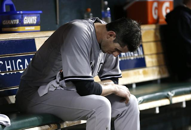 New York Yankees pitcher Brandon McCarthy sits on the bench against the Detroit Tigers in the fifth inning of a baseball game in Detroit Tuesday, Aug. 26, 2014. (AP Photo/Paul Sancya)