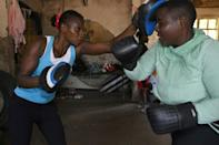 Sarah Achieng (left) spars with Lilian Achieng during a training session in Nairobi