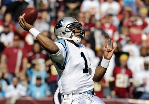 Carolina Panthers quarterback Cam Newton throws the ball during the first half of an NFL football game against the Washington Redskins Sunday, Nov. 4, 2012, in Landover, Md. (AP Photo/Alex Brandon)