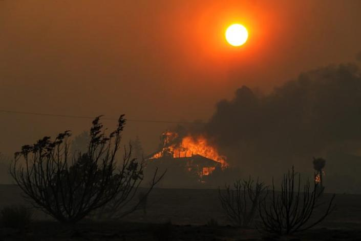 LITTLE ROCK, CA - SEPTEMBER 18: A house burns on Cima Mesa Road in Juniper Hills. Bobcat fire, which started Sept. 6, now rages in Juniper Hills. Wild fire that has now chewed through more than 60,000 acres, has burned through the Angeles National Forest has reached Foothills of the Antelope Valley in three different locations burning near Devil's Punchbowl nature area , the second is advancing toward Tumbleweed Road from Cruthers Creek, and the third has jumped Juniper Hills Road at Longview Road Juniper Hills on Friday, Sept. 18, 2020 in Little Rock, CA. (Irfan Khan / Los Angeles Times)