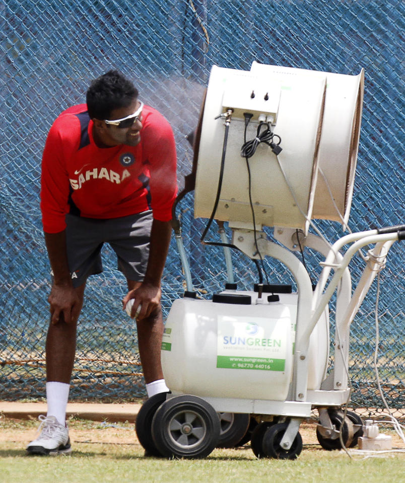 Indian cricketer Ravichandran Ashwin cools himself in front of a vaporizer during a practice session ahead of the World Cup Cricket Group B with Kenya in Chennai, India, Wednesday, March 16, 2011.