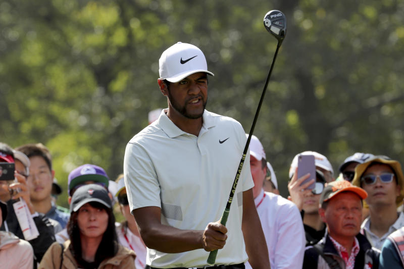Tony Finau of the United States lines up his shot during the HSBC Champions golf tournament at the Sheshan International Golf Club in Shanghai on Thursday, Oct. 31, 2019. (AP Photo/Ng Han Guan)