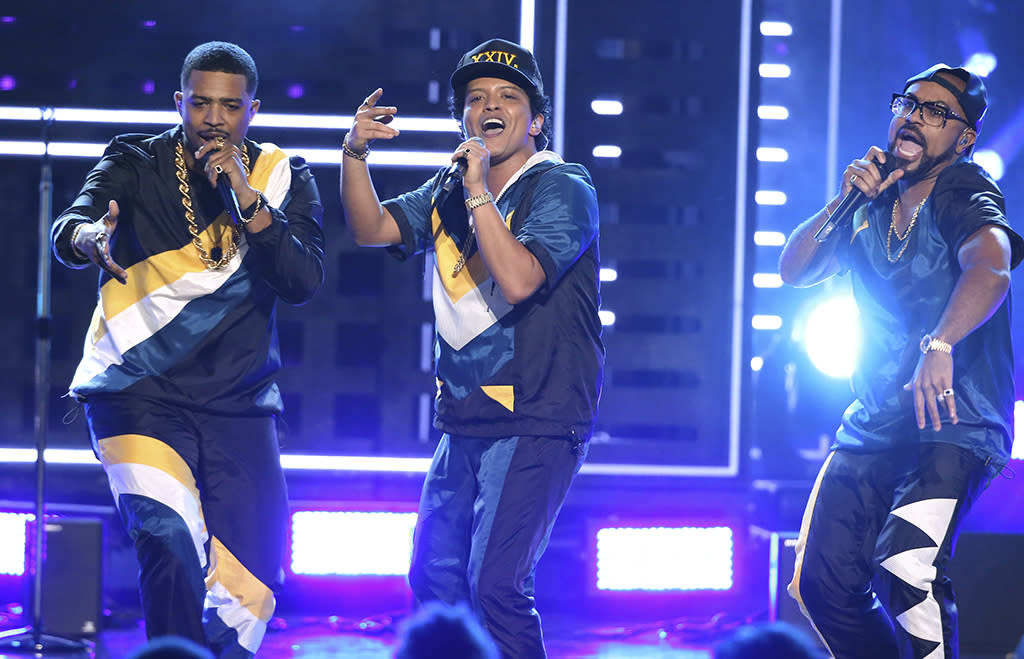 "<p>Bruno Mars, center, performs ""24K Magic"" at the American Music Awards at the Microsoft Theater on Sunday, Nov. 20, 2016, in Los Angeles. (Photo by Matt Sayles/Invision/AP) </p>"
