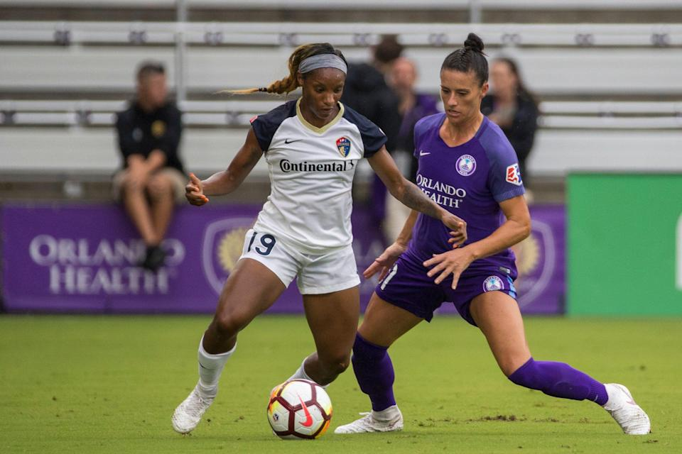 ORLANDO, FL - JUNE 30: North Carolina Courage forward Crystal Dunn (19) and Orlando Pride defender Ali Krieger (11) go for the ball during the soccer match between the Orlando Pride and the NC Courage on June 30, 2018 at Orlando City Stadium in Orlando FL. (Photo by Joe Petro/Icon Sportswire via Getty Images)