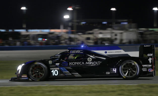 Konica Minolta Cadillac DPi-V.R driver Renger van der Zande competes on the track during the Rolex 24-hour auto race at Daytona International Speedway, Saturday, Jan. 25, 2020, in Daytona Beach, Fla. (AP Photo/Terry Renna)