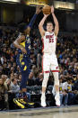 Miami Heat forward Duncan Robinson (55) shoots over the defense of Indiana Pacers guard Aaron Holiday (3) during the first half of an NBA basketball game in Indianapolis, Wednesday, Jan. 8, 2020. (AP Photo/AJ Mast)