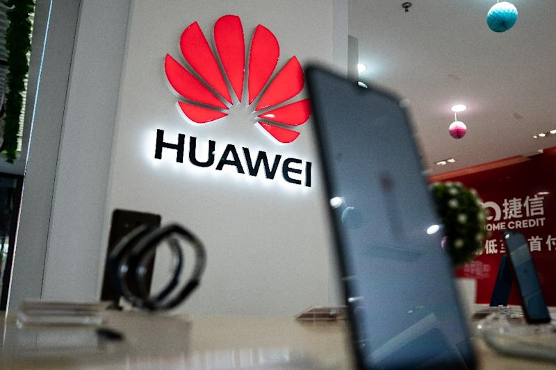 An ongoing trade dispute is unlikely to be helped by a fresh US move against Huawei (AFP Photo/FRED DUFOUR)