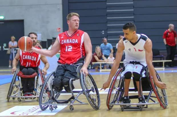 Canadian Patrick Anderson, centre, struck gold with Canada at the Sydney Olympics, Athens Games, and London Olympics, in addition to winning silver at the 2008 Beijing Games. (Wheelchair Basketball Canada - image credit)