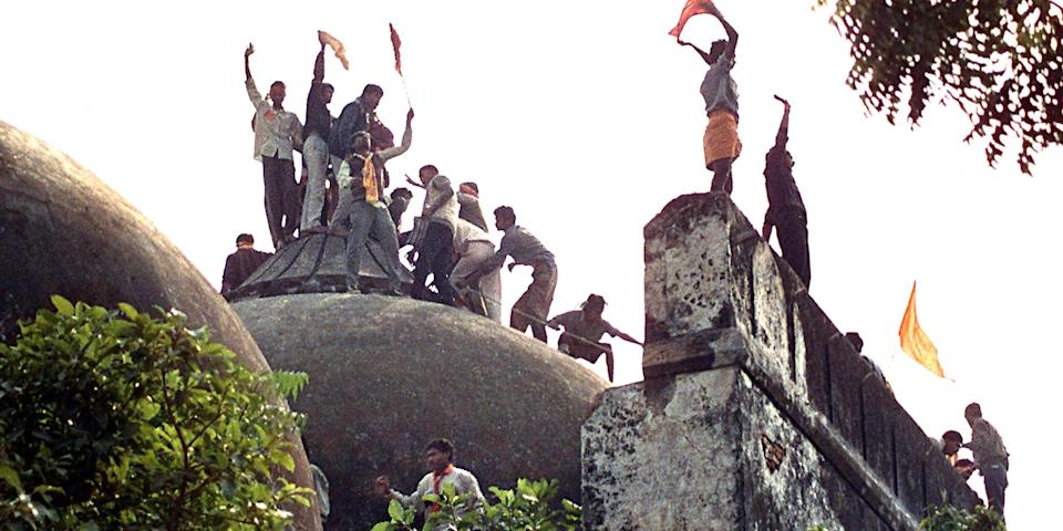 Kar sevaks atop the Babri Masjid shortly before it was demolished on December 6, 1992 at Ayodhya. Photo: Sanjay Sharma/Hindustan Times via Getty Images