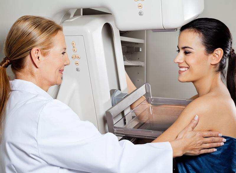 woman getting screened mammogram