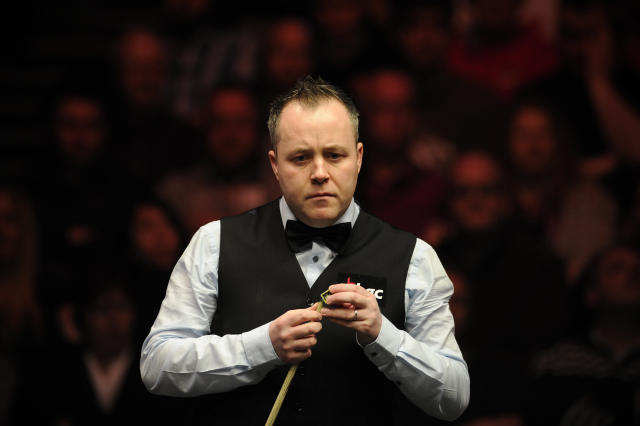 John Higgins of Scotland gestures during his match against Shaun Murphy of England during the semi-final match in the BGC Masters snooker tournament at Alexandra Palace in north London on January 21, 2012. AFP PHOTO / CARL COURT (Photo credit should read CARL COURT/AFP/Getty Images)