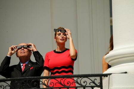 White House Senior Adviser Ivanka Trump and Commerce Secretary Wilbur Ross (L) watch the solar eclipse from the Truman Balcony at the White House in Washington, U.S., August 21, 2017. REUTERS/Kevin Lamarque