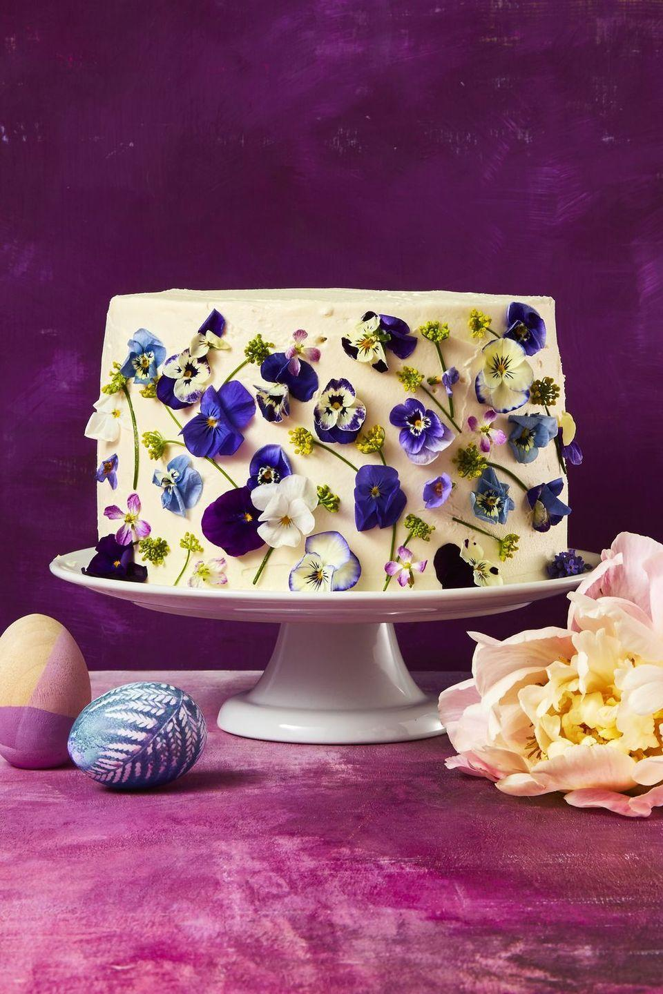 """<p>Dress up a classic cake with beautiful (and edible!) flowers to turn it into the centerpiece of your dessert table.</p><p><em><a href=""""https://www.goodhousekeeping.com/food-recipes/dessert/a48178/vanilla-blossom-cake-recipe/"""" rel=""""nofollow noopener"""" target=""""_blank"""" data-ylk=""""slk:Get the recipe for Vanilla Blossom Cake »"""" class=""""link rapid-noclick-resp"""">Get the recipe for Vanilla Blossom Cake »</a></em></p><p><strong>RELATED:</strong> <a href=""""https://www.goodhousekeeping.com/holidays/easter-ideas/g26557097/easy-easter-desserts/"""" rel=""""nofollow noopener"""" target=""""_blank"""" data-ylk=""""slk:50+ Easy Easter Desserts That Celebrate the Holiday In a Big Way"""" class=""""link rapid-noclick-resp"""">50+ Easy Easter Desserts That Celebrate the Holiday In a Big Way</a></p>"""