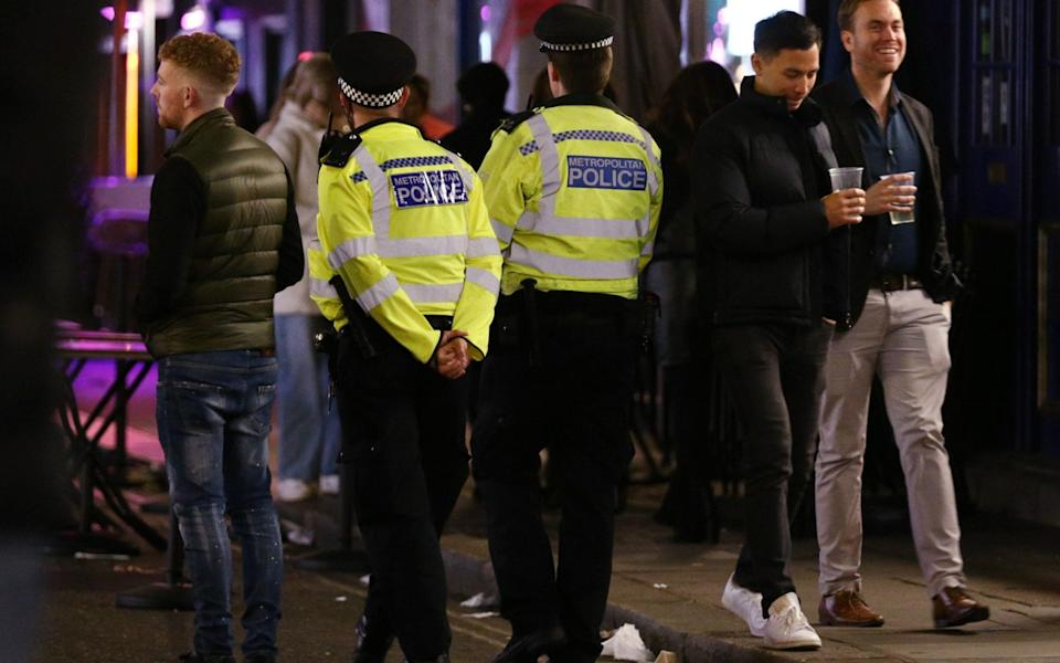 Police officers on patrol ahead of closing time in Soho, London, after pubs and restaurants were subject to a 10pm curfew -  Yui Mok/PA