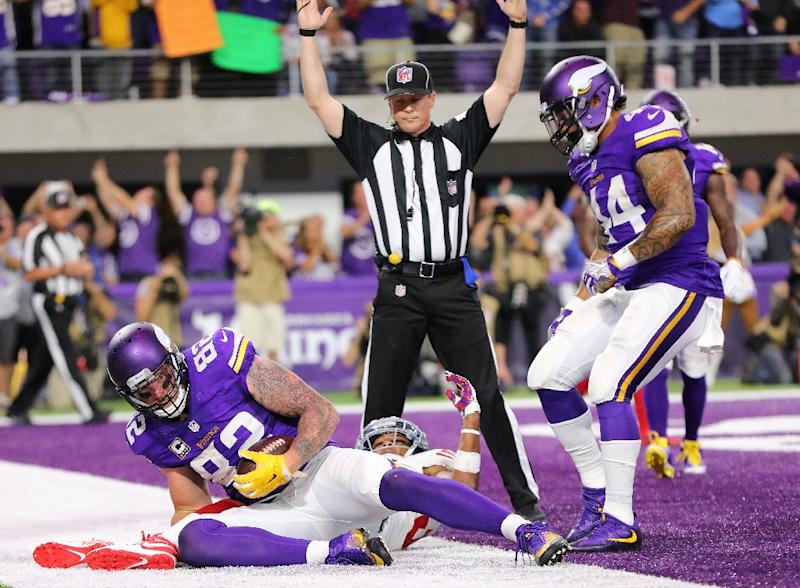 Kyle Rudolph of the Minnesota Vikings scores a touchdown in the second quarter of the game against the New York Giants on October 3, 2016 in Minneapolis, Minnesota