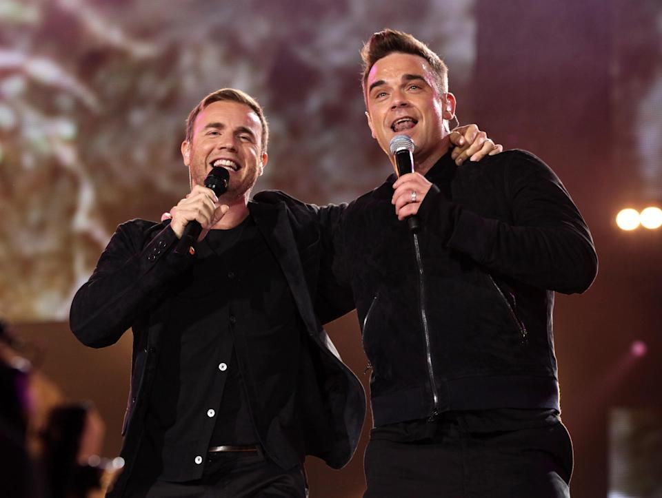 Robbie Williams (right) and Gary Barlow performing at the Help For Heroes Concert at Twickenham Stadium, south west London.