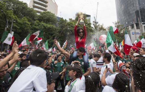 Thousands of soccer fans and Gay Pride revelers converge on Mexico Citys Angel of Independence on Reforma Avenue, Saturday, June 23, 2018. Soccer fans were celebrating Mexicos victory over Korea in todays World Cup soccer match as they met the massive Gay Pride Parade marching towards down town Mexico City. (AP Photo/Christian Palma)